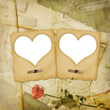 Old grunge paper frame with heart. On the ancient background Royalty Free Stock Images