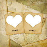 Old grunge paper frame with heart. On the ancient background Royalty Free Stock Image