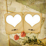 Old grunge paper frame with heart. On the ancient background Royalty Free Stock Photos