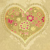 Old grunge paper with gold heart Royalty Free Stock Images