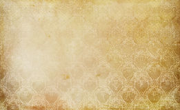 Old grunge paper texture and vintage floral ornament. Stock Photos