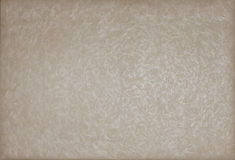 Old grunge paper textured pattern. Old pearlised textured beige paper background Royalty Free Stock Photo