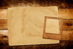 Old grunge paper on the wooden background. Old grunge paper slide on the wooden background Royalty Free Stock Photos