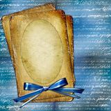 Old grunge papers with bow blue background Royalty Free Stock Photos