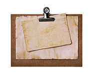 Old grunge papers close-up on brown clipboard Royalty Free Stock Photo