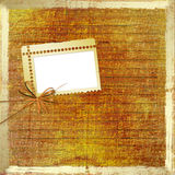 Old grunge photoalbum for photos with bow. And ribbons Stock Photos