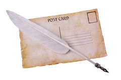 Old grunge postal card and feather pen Royalty Free Stock Photos