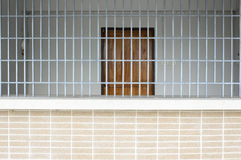 Old Grunge Prison seen through Jail Bars Stock Images