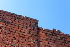 Old grunge red brick wall and blue sky Stock Photo