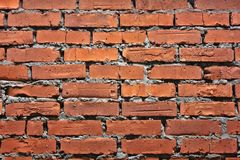 Old grunge red brick wall texture or background, closeup Stock Image