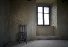 Old grunge room. Chair in old grunge room Rupea Royalty Free Stock Photography