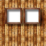 Old grunge room with wooden picture frames Royalty Free Stock Photos