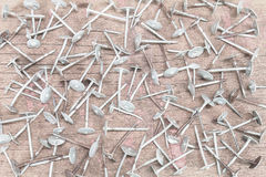 Old grunge rusty nails on vintage wooden background Stock Photography