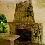 Old grunge shelter building with fireplace in forest Stock Image
