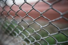 Old grunge steel fence. Blur with outdoor park background Royalty Free Stock Photos