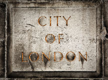 Old grunge stone board with City of London text. Old grunge stone board with golden City of London text Stock Photos