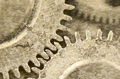 Old grunge texture of steel gears. Macro. Sepia Stock Photos