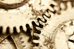Old grunge texture of steel gears. Macro. Sepia Stock Images