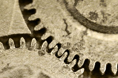 Old grunge texture of steel gears. Macro. Sepia Royalty Free Stock Photography