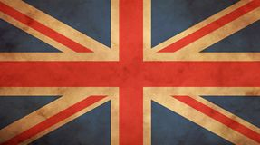 Old vintage UK British flag over paper parchment. Old grunge vintage dirty faded UK Great Britain national flag over background of brown kraft paper parchment stock photography
