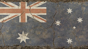 Old grunge vintage faded flag of Australia. Old grunge vintage dirty faded shabby distressed Commonwealth of Australia national flag background on broken Stock Photo