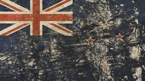 Old grunge vintage faded flag of New Zealand. Old grunge vintage dirty faded shabby distressed New Zealand national flag background royalty free stock photography