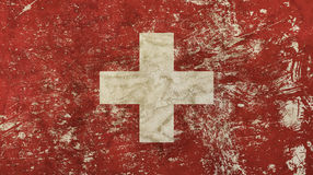 Old grunge vintage faded Swiss Confederation flag. Old grunge vintage dirty faded shabby distressed Swiss Confederation or Switzerland national flag background stock photos