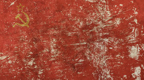 Old grunge vintage faded USSR Soviet Union flag. Old grunge vintage dirty faded shabby distressed former USSR Soviet Union national red flag background with star Royalty Free Stock Photography