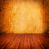 Old grunge wall. With parquet wood floor Stock Photo