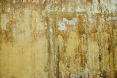 Old grunge wall. A dirty grunge wall with cracked, peeling paint and rusty texture Stock Images