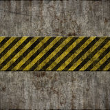 Old grunge wall with hazard sign Royalty Free Stock Photography