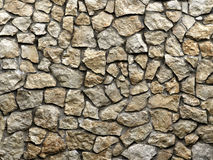 Old grunge wall of rough stones as background Stock Image
