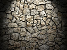 Old grunge wall of rough stones as background , light effect Stock Photos