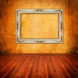 Old grunge wall with vintage frame Stock Photo