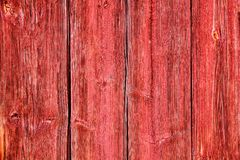 Old grunge and weathered red wooden wall planks texture background. Marked by long exposure to the elements outdoors Stock Image