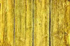 Old grunge and weathered yellow wooden wall planks texture background stock photography