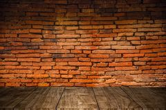 Old grunge wood foreground with old brick wall Stock Photo