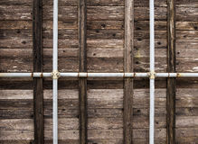 Wooden wall with pipes Royalty Free Stock Photo