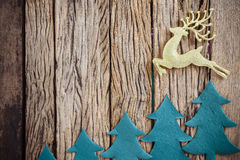 Old grunge wooden board with Christmas border. Stock Image