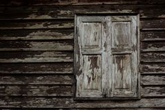 Old grunge wooden window of Thai house Stock Images