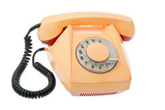 Old grunge yellow with red telephon. Isolated on white background Royalty Free Stock Photography