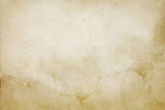 Old grunge yellowed paper texture. Yellowed aged paper background for the design Royalty Free Stock Images