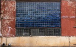 Old grungy block glass and painted concrete warehouse texture from USSR royalty free stock photos
