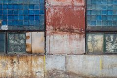 Old grungy block glass and painted concrete warehouse texture from USSR royalty free stock image