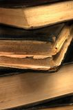 Old grungy books closeup in sepia shallow DOF Stock Photography