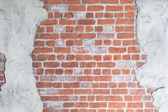 Old grungy brick wall with concrete stucco. Loft decoration Royalty Free Stock Images
