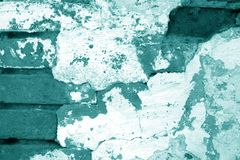 Old grungy brick wall texture in cyan tone. Abstract architectural background and texture for design blue green color cement wallpaper grunge concrete block royalty free stock photo