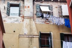 Old grungy building with linen outside Royalty Free Stock Photo