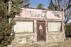 Old grungy building log store vacant Royalty Free Stock Image