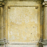 Old grungy framed wall. With pillars for backgrounds Stock Photography